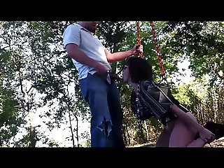 couple have fun with blowjob on public park swing