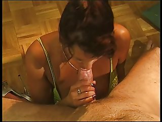 Foxy slut in green bustier hungrily mouth fucks hard white male sausage