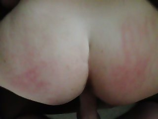 Spanking and fucking her doggystyle