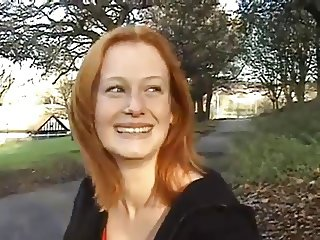 Redhead shows her tits & ass outdoors