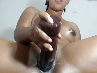 Latina uses big toy and her fist in pussy