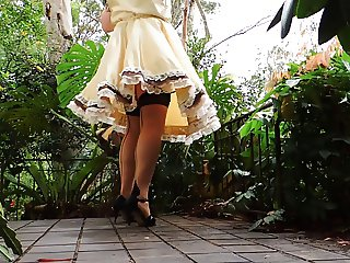 Sissy Ray in Gold Sissy Dress on Windy Day