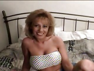 Mature solo on bed