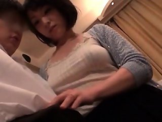 Asian mature office chick giving her boss a big boner
