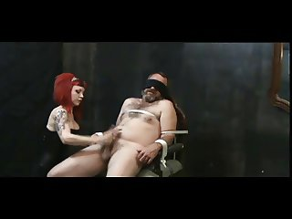 Redhead mistress milking a tied slave