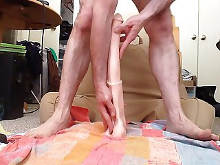 Deep penetration of huge dildo...