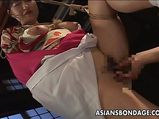 Hot tied up Asian lady with big boobs teased