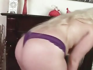 Raphaella Lily Performs A Sexy Striptease