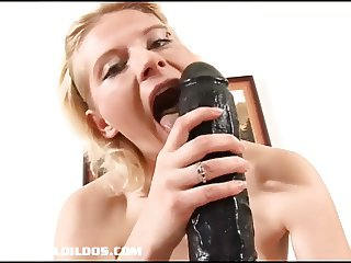 Blonde amateur fills her pussy with a big brutal dildo