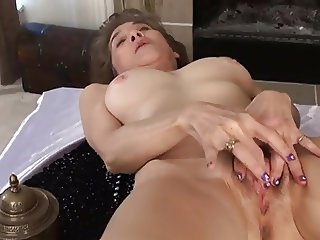 mature rubs her hairy pussy