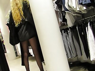 Skinny blonde in black nylons at H & M.