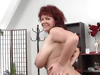 Sexy mature redhead shows her huge tits and ass