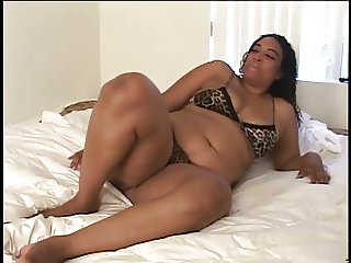 Fat black slut slides a clear dildo inside her wet pussy