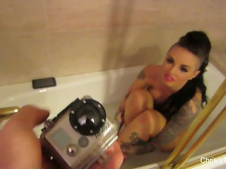 Busty starlet Christy Mack takes a bath
