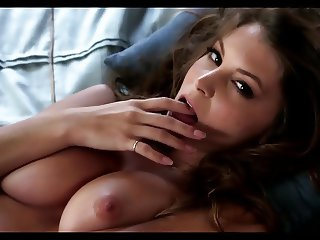 Amber Sym teases us with her nice tight pussy on the bed