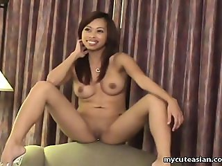Asian hottie showing off her huge melons on c