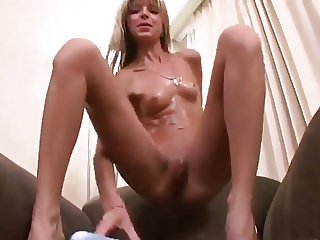skinny girl plays with dildo