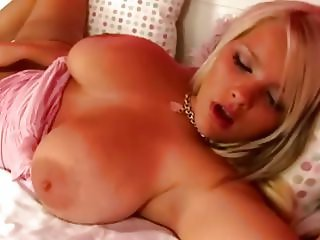 Super hot blonde with  huge tits