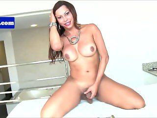 Busty brazilian jerks her cock until cumshot