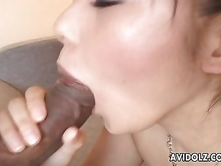 Stunning Asian has a fat erect cock she is gobbling up