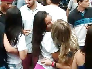 Three girls kissing public