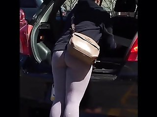 PUTTING A PLANT IN HER TRUNK