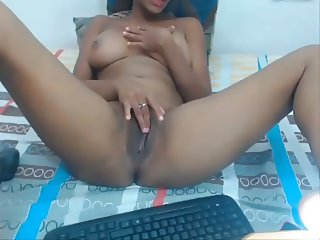Black latin girl is rubbing her clit like crazy