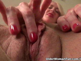 American milf Eva Griffin fingers her nyloned wet pussy