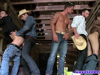 Three hunky cowboys assfuck twinks in barn