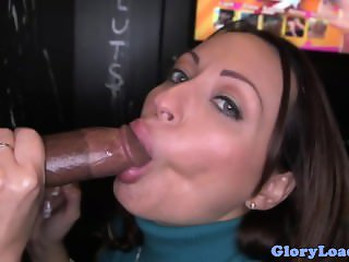 Gloryhole loving brunette swallows cum