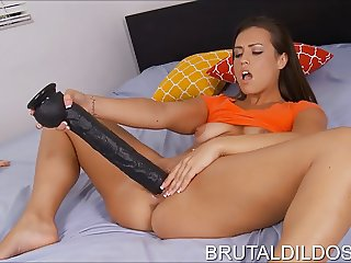 Sexy babe with a long brutal dildo