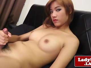Asian tgirl tugging her penis