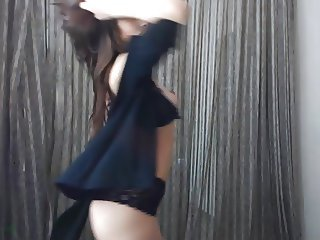 Brunnete dancing in topless in a webcam