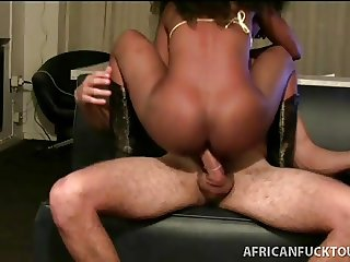 Black beauty in boots takes white cock