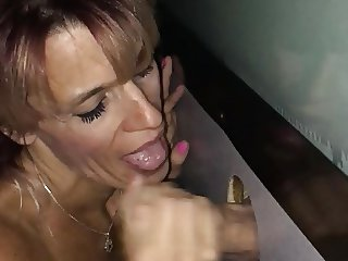Sucking Thick Cock at the Glory Hole