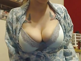 Busty Tattoed Babe Pissing