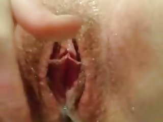 Girlfriend rubbing her pussy peeing golden streams of piss