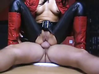 wife in leather and high boots takes anal pounding