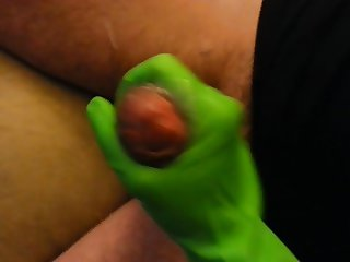 Wife Jerks Cock with Green Rubber Gloves