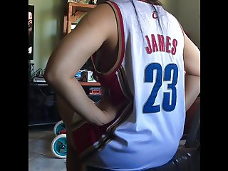 Sister wearing loose jersey at home