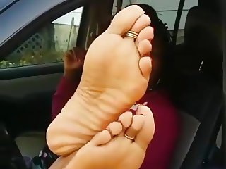 Ebony soles in car window