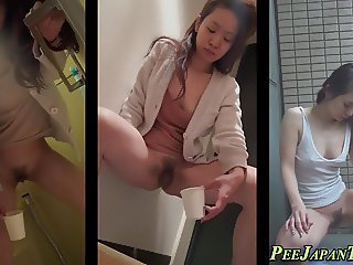 Weird asian babe pisses