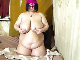 bbw wife rubbing ice and oil on her huge tits