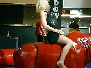 Girls riding mechanical bull