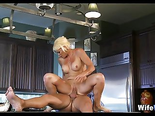 Blonde MILF gets kitchen Cock