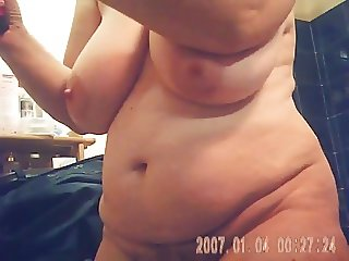 mature with big tits, curvy belly and hairy pussy