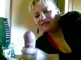 Mature Mom handjob its friend and he cumshot her on face.