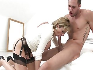 British lady in stockings and heels fucks young guy