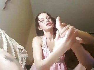 Hot russian licks feet in living room