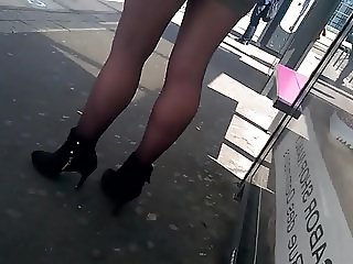 Slow motion woman with high heels and pantyhose waiting
